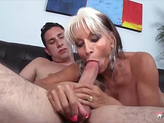 Big titted grandma, Sally D'Angelo likes to suck hard dicks until she gets a facial cumshot