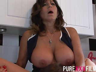 Busty housewife, Tara Holiday was moaning while getting her trimmed pussy licked in all directions the kitchen