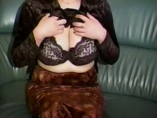 Horn-mad a bit plump unskilful cam MILF plays with her huge knockers