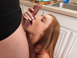 Aroused redhead gags a little before sticking this monster inside