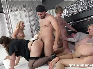 A organize of horny mature women rent two young men to fuck them