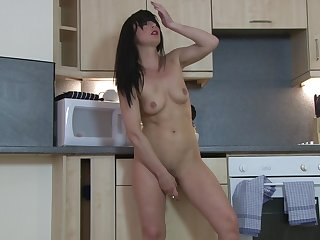 Solo video of small boobs Roxanne having some fun apropos the kitchen