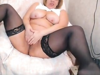 mature opens obese pussy wide