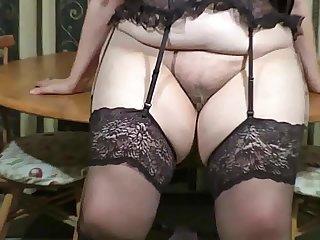 Striptease grandma beside stockings