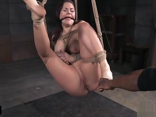 Struggling busty sub gets tied up and caned